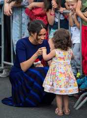 Meghan, Duchess of Sussex, holds hands with a young girl during a walkabout in Rotorua on day four of the royal couple's tour of New Zealand