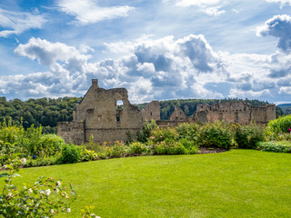 View to the ruins of Larochette Castle above the town of Larochette, Fiels or Fels in Luxembourg against a dramatic cloudy August sky