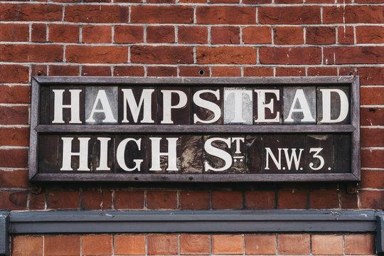 Street name sign on Hampstead High Street, Hampstead, London, UK.