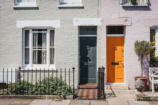 Traditional colourful bright doors on houses in Barnes, London, UK.