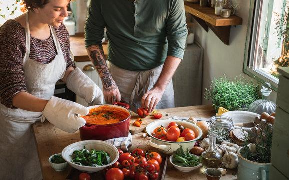 Couple making a tomato soup