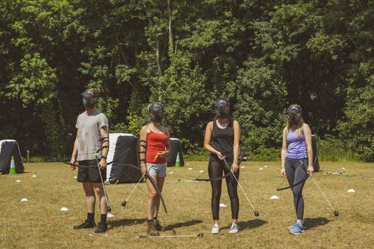 Group of people practicing archery at boot camp