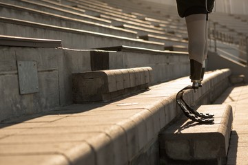 Disabled athletic sanding at sports venue
