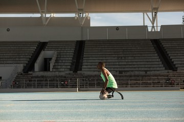 Disabled athletic relaxing on a running track