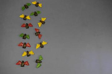 multicolored gummy jelly bat candies over dark background