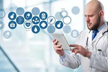 Doctor with digital tablet and variety medical