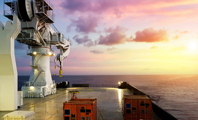 Amazing Sunset view from a modern offshore ship with a large crane on deck