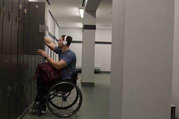 Disabled man listening music on headphones