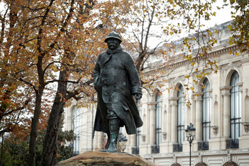 The bronze statue of Georges Clemenceau stands next to the Petit Palais in Paris