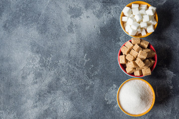 White sugar and brown sugar cane cube on the dark background of the brutal Selective focus