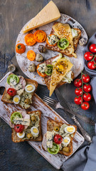 Vertical food banner. Delicious Toasts with grilled cheese, quail eggs, cream cheese and nuts. Author's cuisine and creative presentation