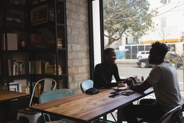 Couple interacting with each other in cafe