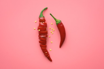 Sliced Red Chili Pepper on pink background. Top view. Food ingredient. concept