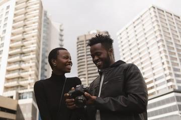 Man reviewing photos on digital camera