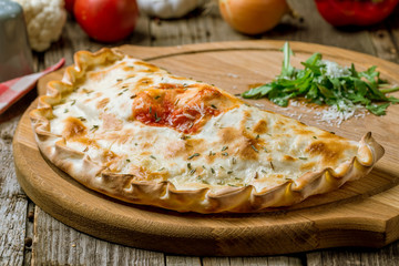Closed calzone pizza