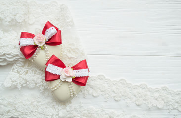 winter holiday decoration. Handmade Christmas tree toy decorated with a satin red ribbon, plastic flowers, pearls, lace.