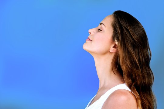 Pretty woman smiling, side view, isolated on