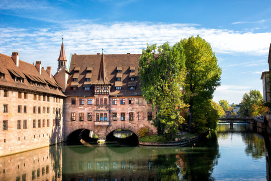 Nuremberg, Heilig-Geist-Spital which is reflected in the waters of the Pegnitz river. Franconia, Germany