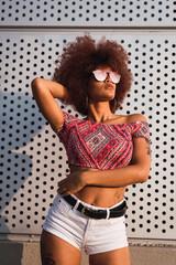 Portrait of fashionable woman wearing mirrored sunglasses