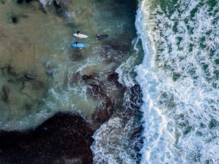 Indonesia, Bali, Aerial view of Dreamland beach, three surfers from above