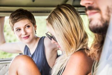 Smiling friends in a van