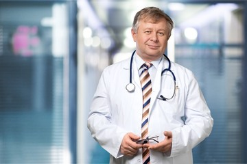 Smiling medical doctor with stethoscope. Isolated over