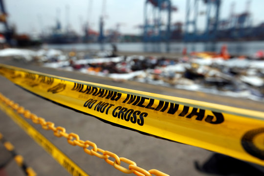 Police line is seen outside recovered debris of Lion Air flight JT610, which crashed into the sea, at Tanjung Priok port in Jakarta