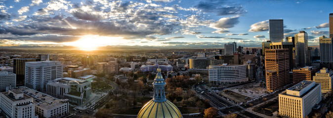 Aerial/Drone panorama of the capital city of Denver, Colorado at sunset.  The Rocky Mountains can be seen on the horizon Wall mural