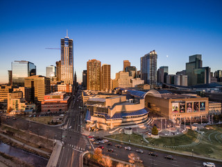 An aerial view of the skyline of the city of Denver at sunset
