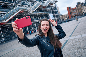 The girl makes selfie in  Paris