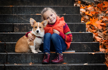 little girl and puppy on the steps