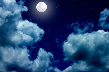 The bright night sky with full moon and white cloud.