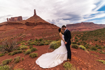 Asian/Vietnamese Bride with White Groom Posing for Wedding Photos in the Barren Utah Desert of Castle Valley, Near Moab.