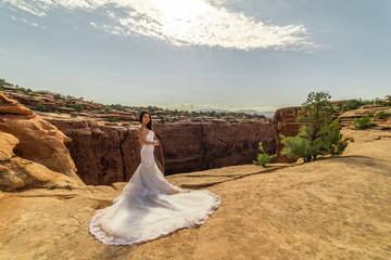Asian/Vietnamese Bride in her Wedding Dress.  Taken in the Utah desert, near Moab.
