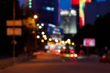 A far view blurred background of night busy city centre.
