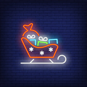 Santa sleigh neon sign. Glowing illustration of red sledge with bright gifts. Can be used for invitations, decoration, advertisement