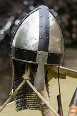 A medieval helmet with a nose guard.