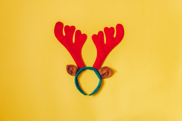 Christmas Background Flat Lay Top View Of Reindeer Antlers On Yellow Perfect For