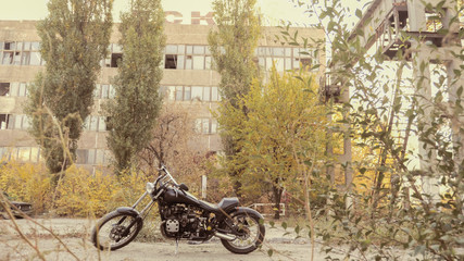Motorbike in the city,Industrial district,vintage photo effect added