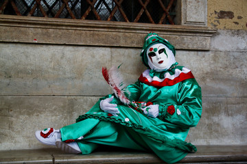 Carnival green-red-white mask and costume at the traditional festival in Venice, Italy
