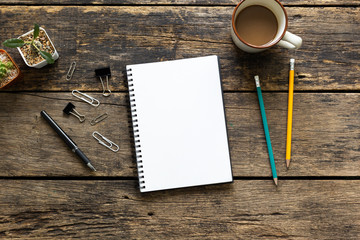 Empty notebook on wooden table top view