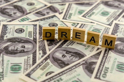 Word Dream On One Hundred Dollar Bills Background Concept Money Buys Dreams