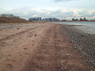 empty sandy beach in cloudy weather