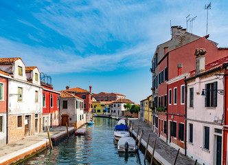 colorful houses on the island of murano near venice in summer