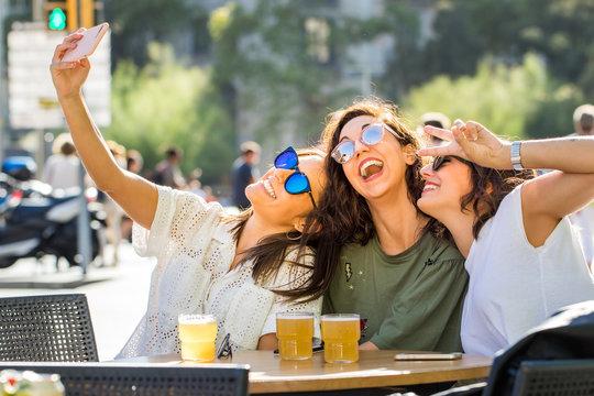 Fun girl friend selfie on terrace.
