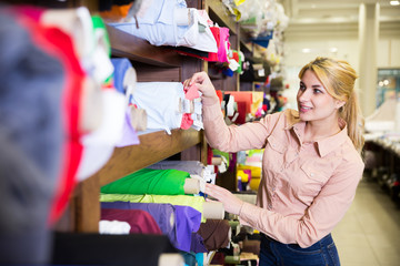 Woman looking for cloth in shop