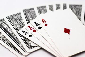 Ace from each Suit fanned out across back of cards, abstract, chance, gambling, poker, money, win, lose
