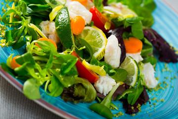 Salad with pickled merluccius