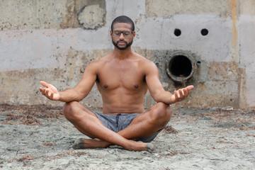 Meditation Practice by Male Yoga Teacher at the Beach