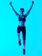 one mixed races woman exercsing fitness exercices jumping happy  isolated on blue blackground